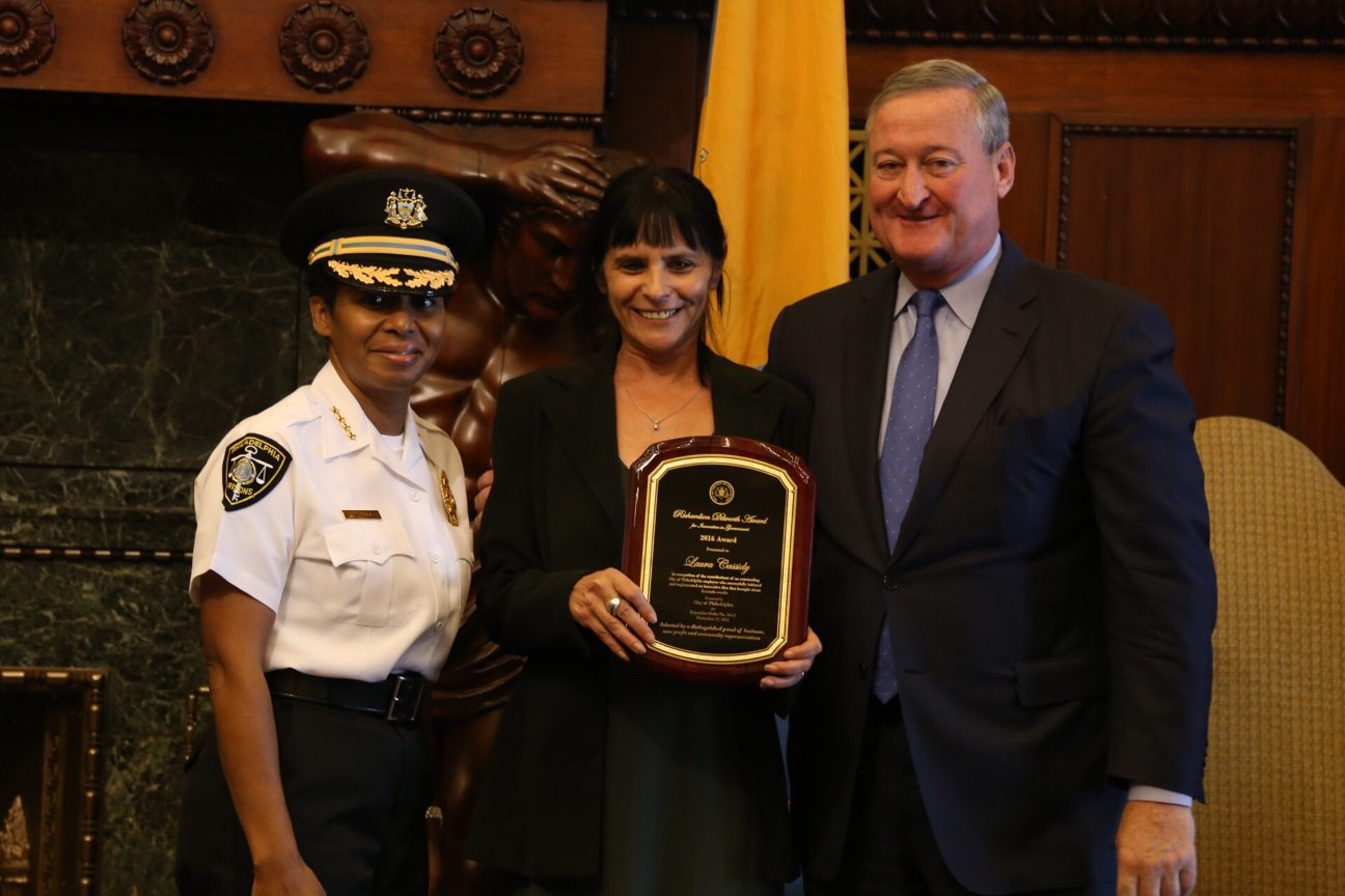 Laura Cassidy accepting her Dilworth Award with Mayor Kenney and Prisons Commissioner Blanche Carney